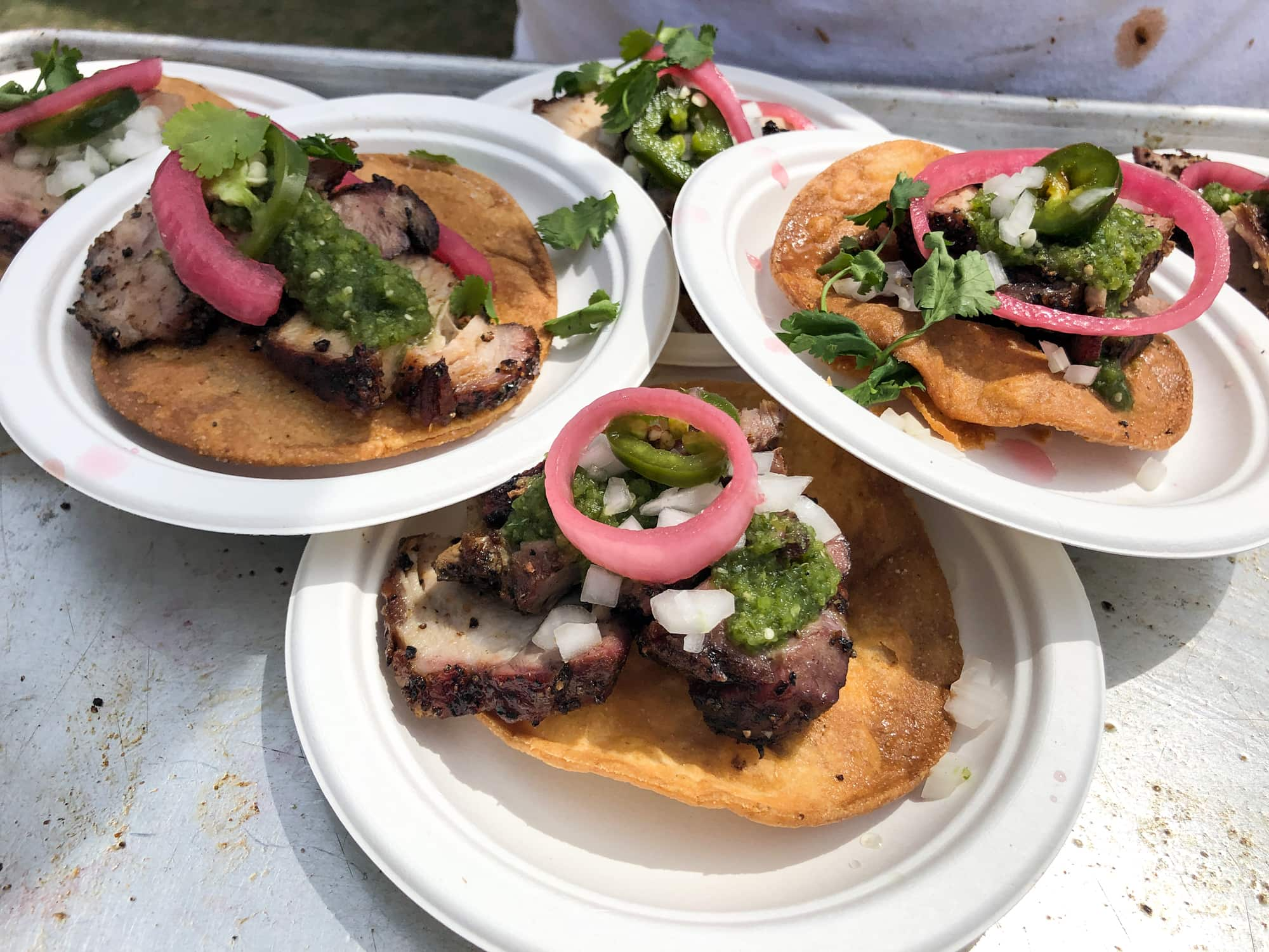 Beef tostadas with onion and chimichurri sauce