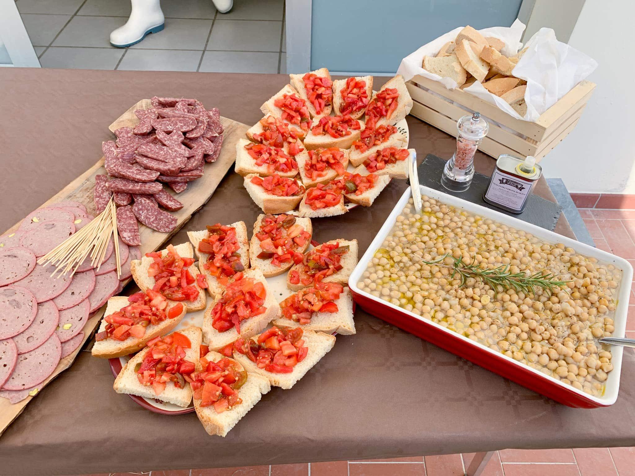 Bruschetta, wild boar sausage, and white beans