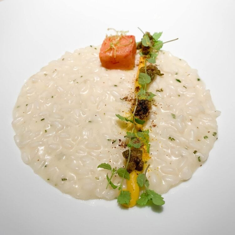Lemon risotto with red prawns, rosemary, and capers