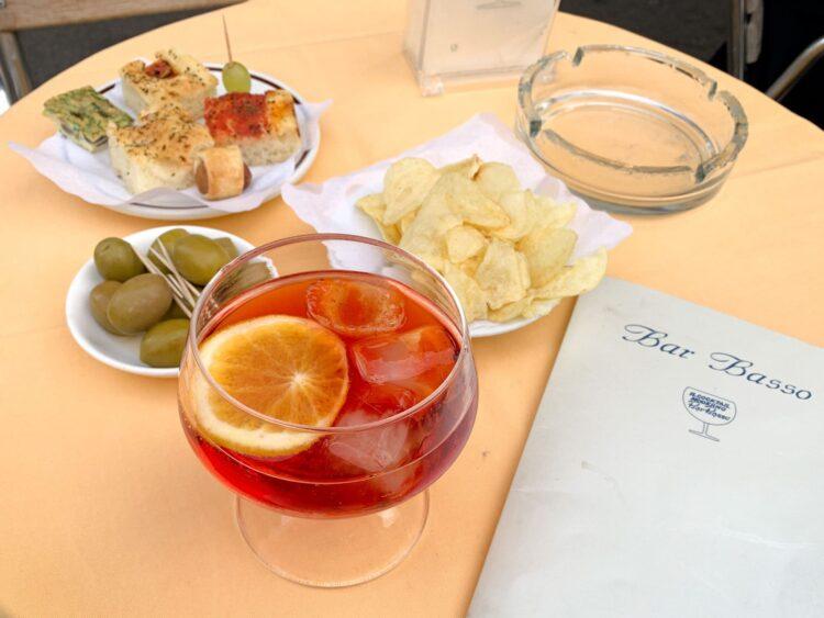A typical Italian aperitivo: Negroni Sbagliato and snacks