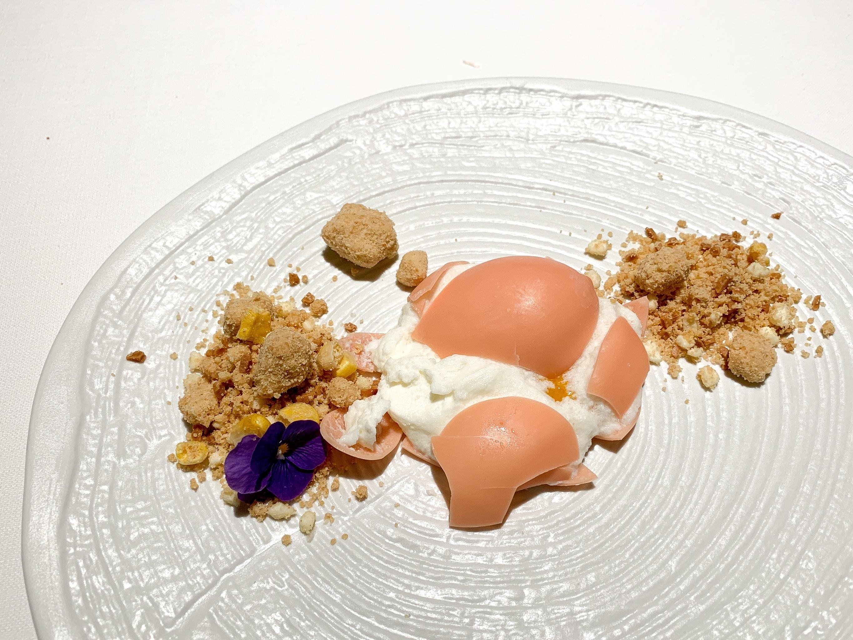 Scrambled egg made of yogurt, mango, and white chocolate