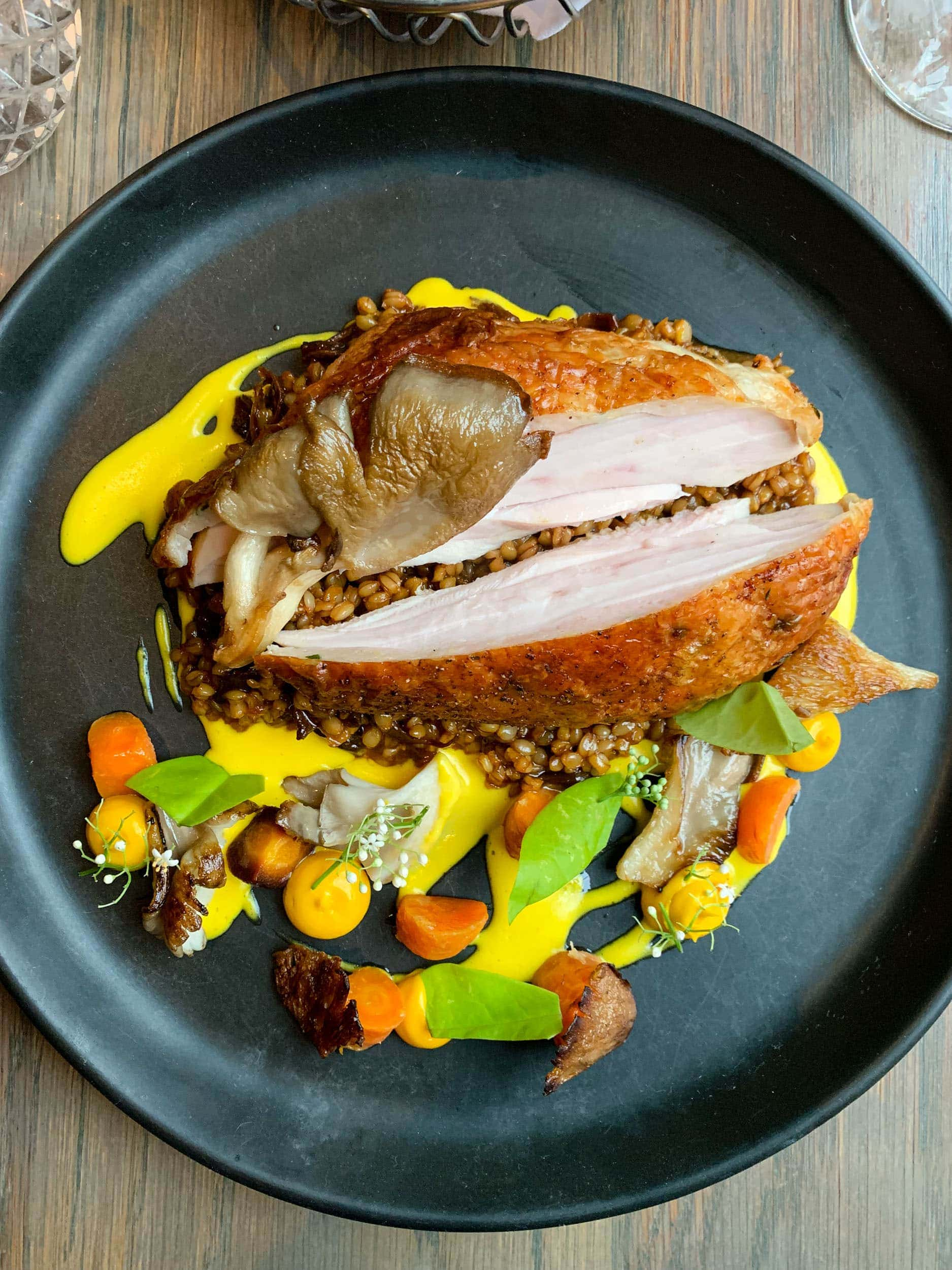 Dewberry Hills Farm chicken with oyster mushroom, carrot, farro, and bay laurel