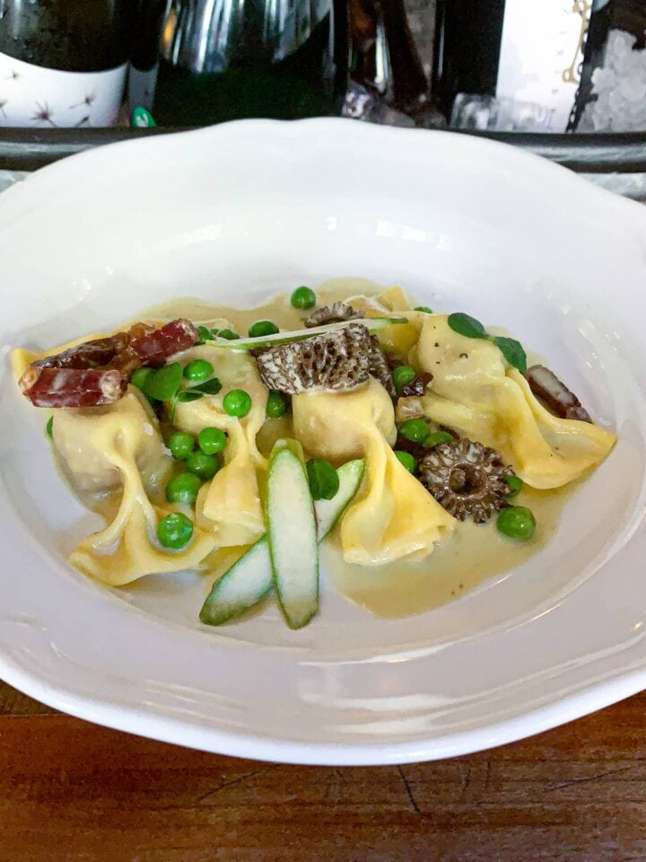 Caramelized onion and beef-stuffed pasta in asparagus butter