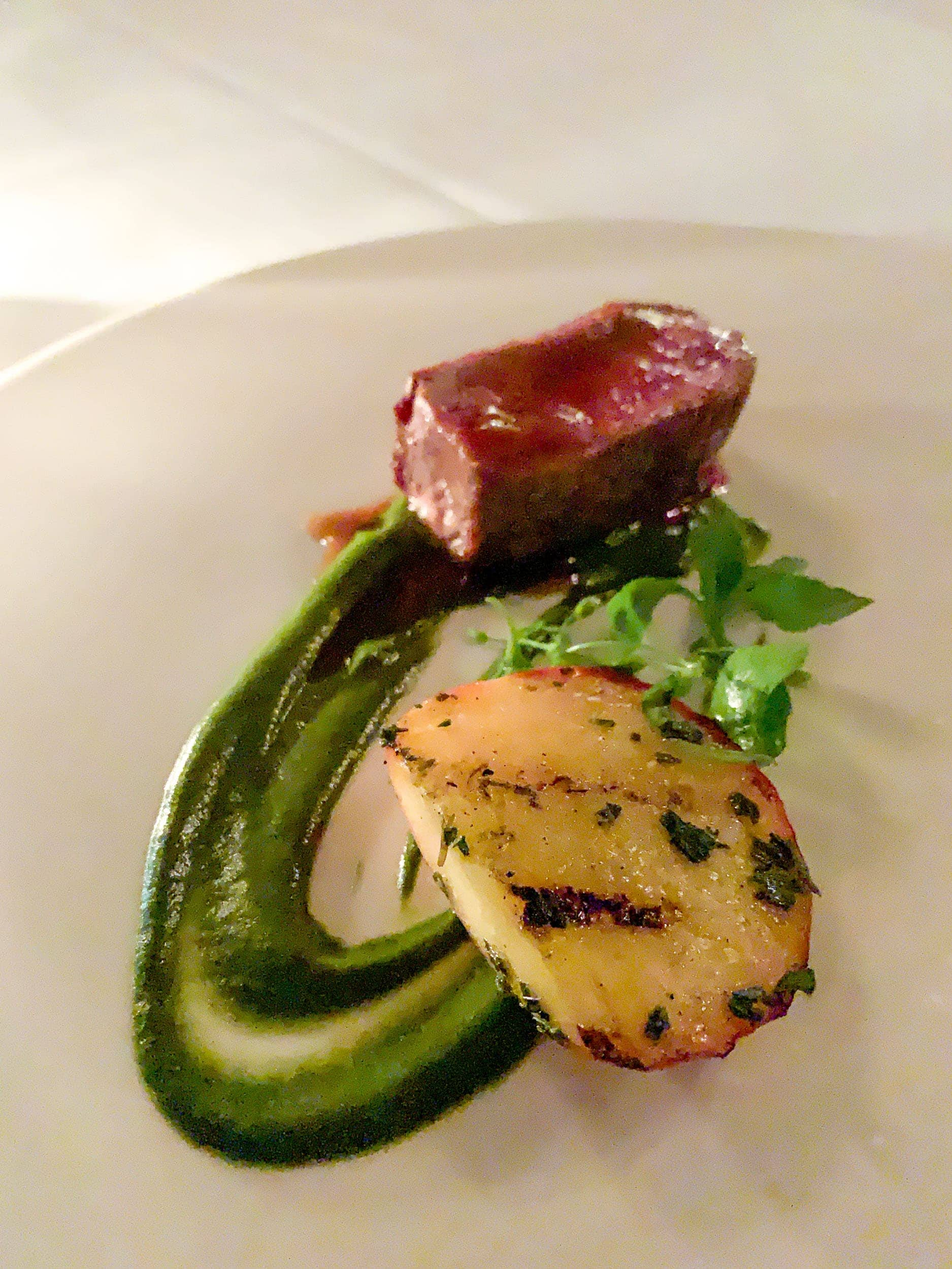 Colorado lamb loin with grilled stone fruit, stinging nettles, and tarragon