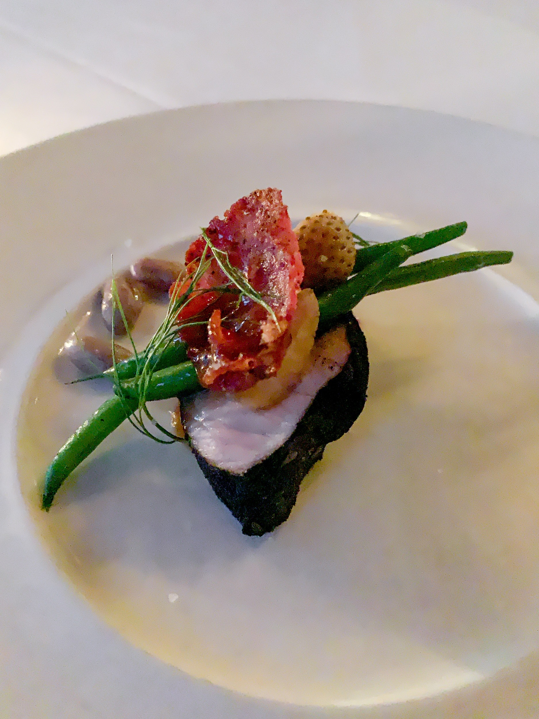 Berkshire pork loin with pickled strawberry, pole beans, and summer sausage
