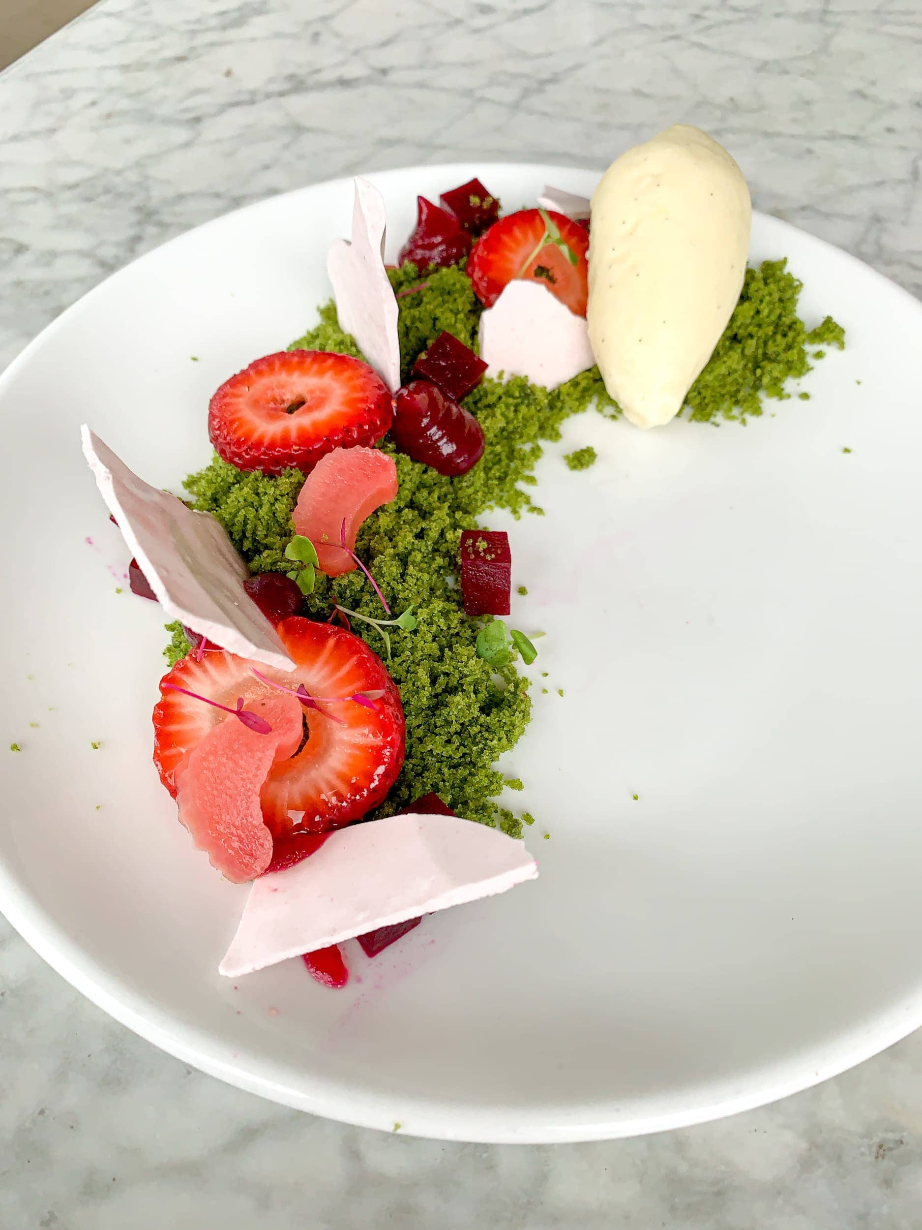 Arugula cake with strawberry, beet, basil, spirulina, and Tahitian vanilla ice cream