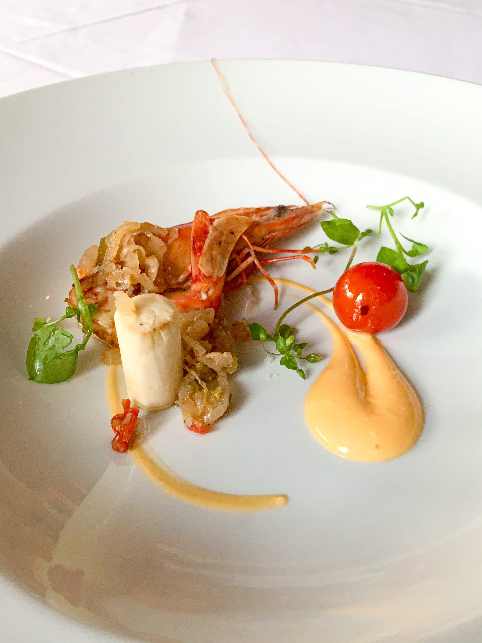 Prawns en escabeche with roasted cherry tomato, hearts of palm, and fresh lychee