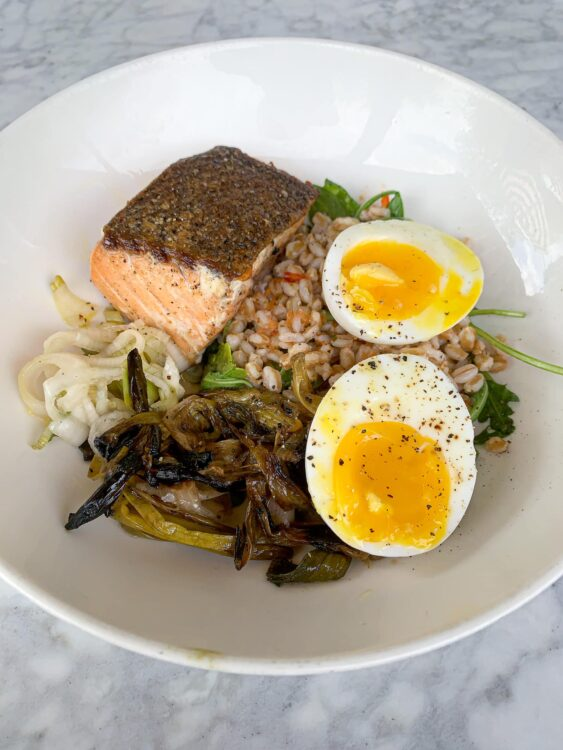 Salmon with farro, broccolini, pickled spring onion, and soft egg