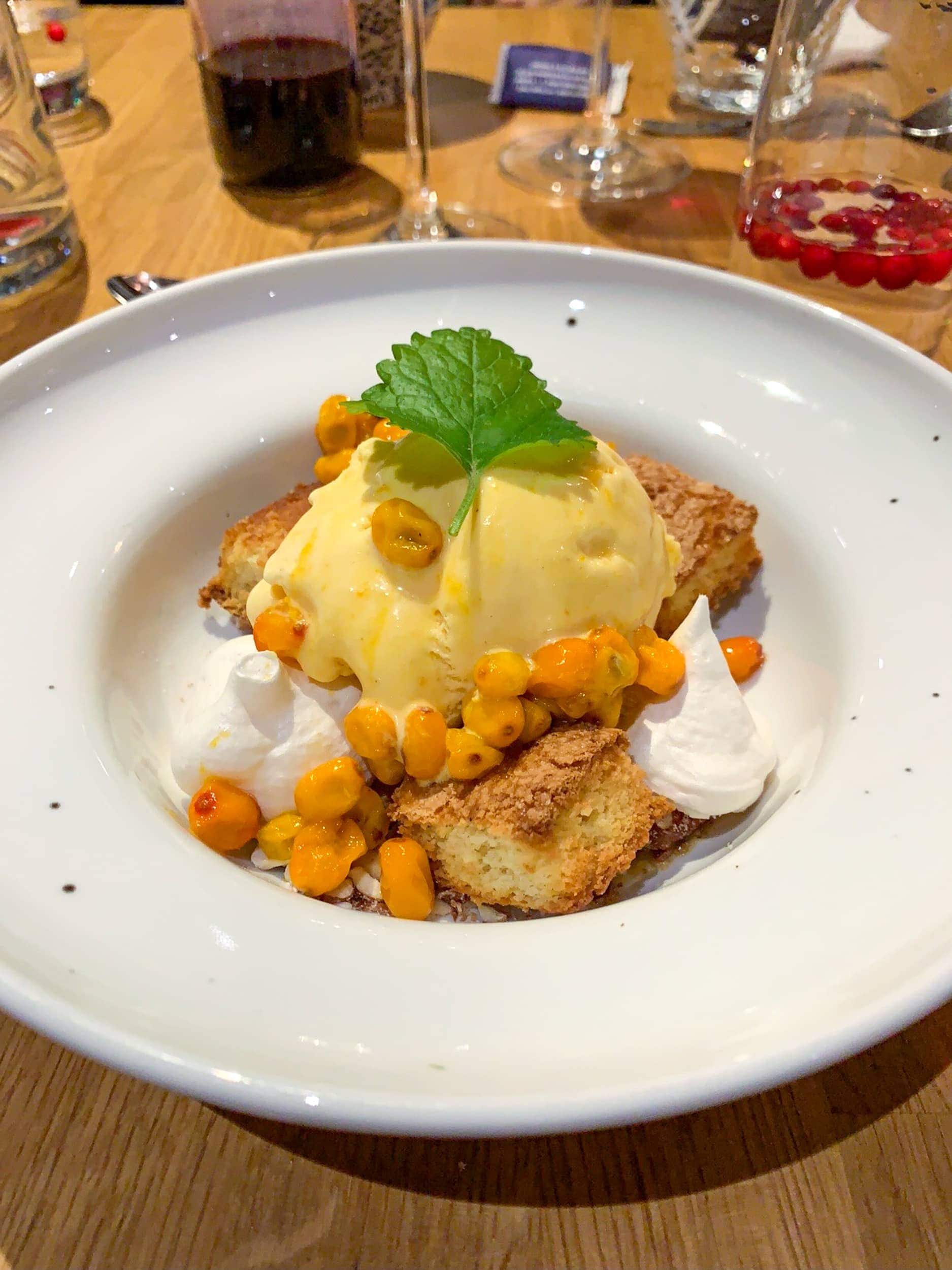 Sea buckthorn ice cream with cloudberries