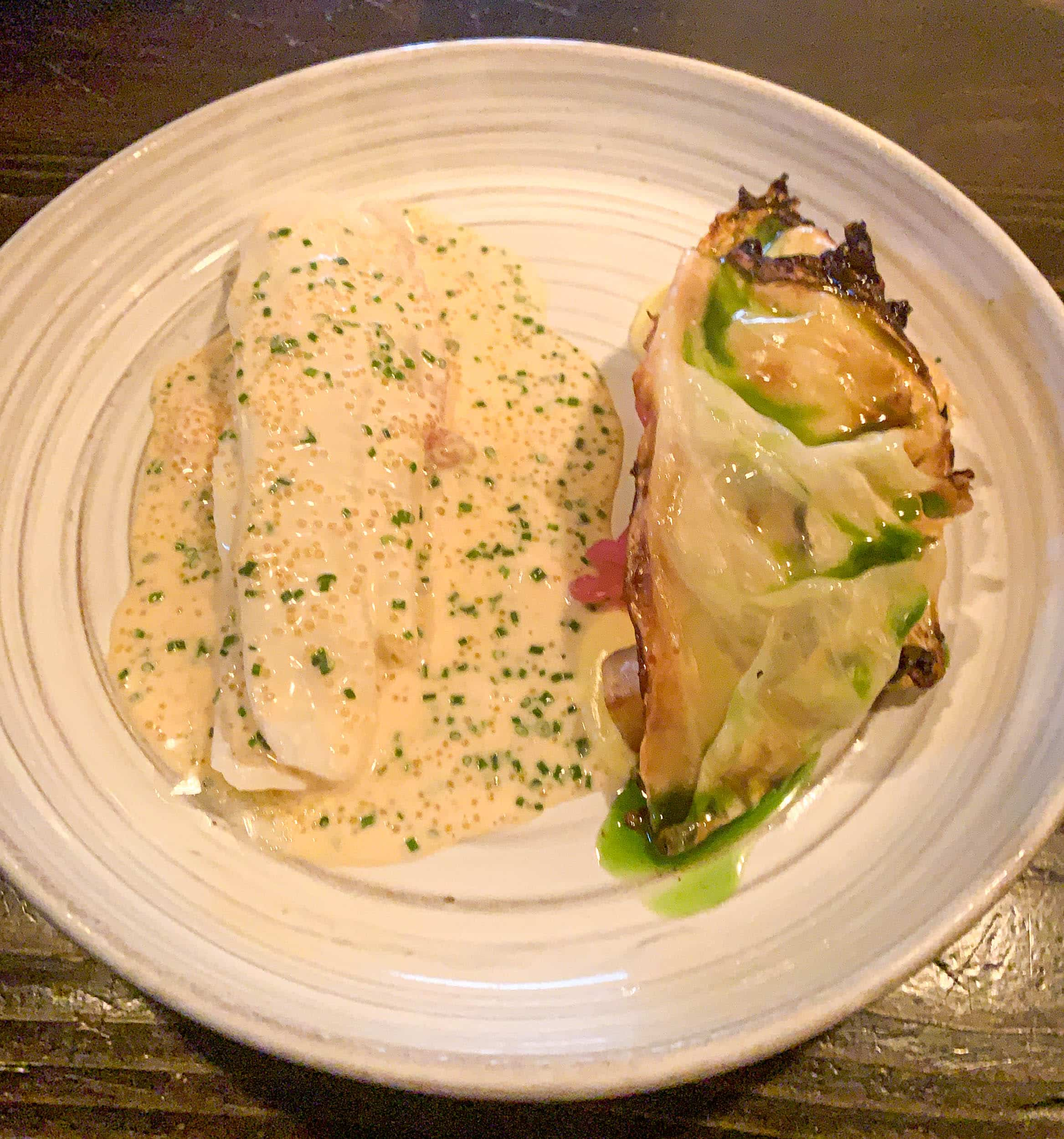 Lemon sole with a cream of aged cheese, celeriac, roasted cabbage, and a smoked clam butter sauce with bleak roe at Restaurang Natur in Gothenburg, Sweden