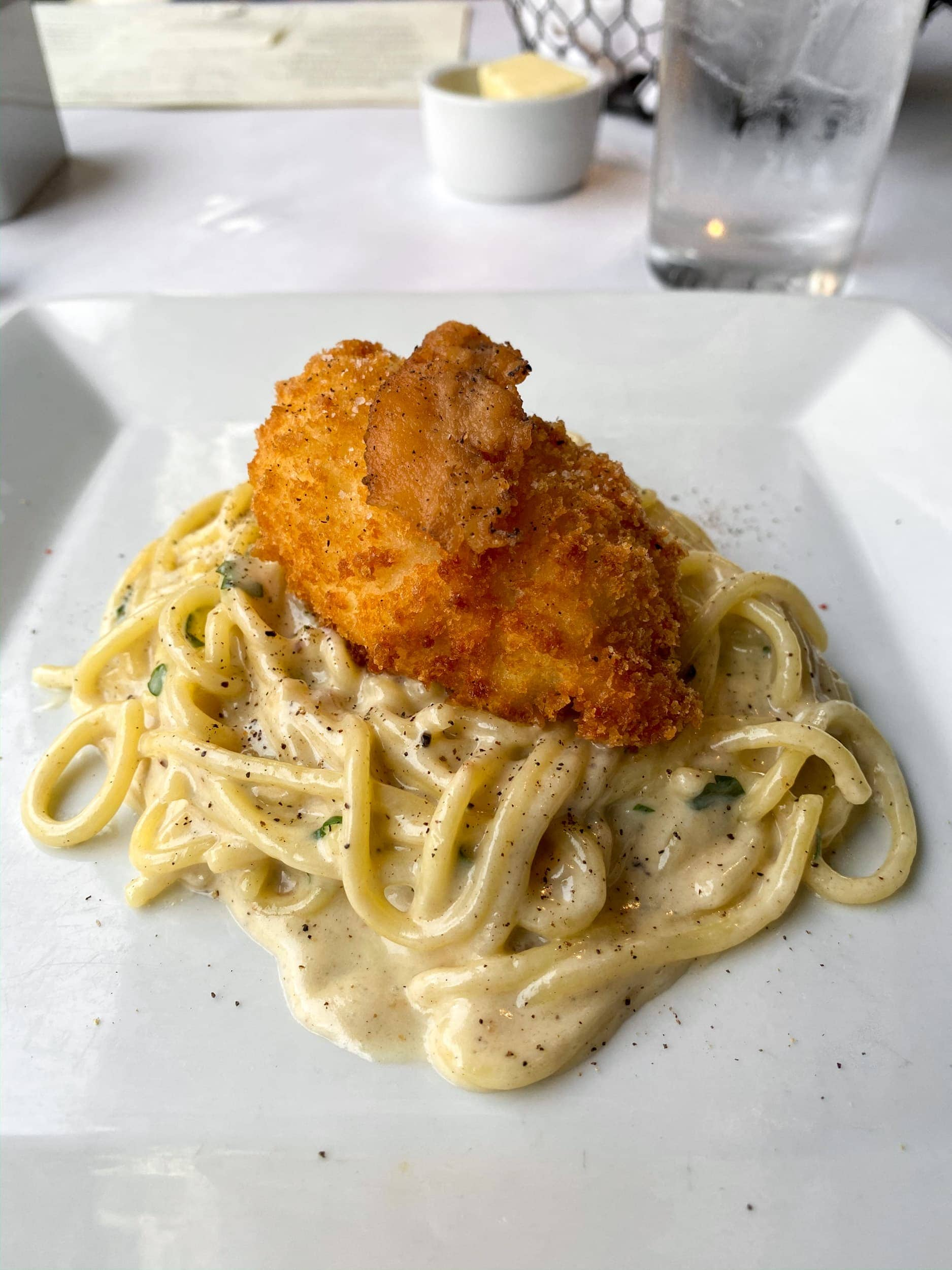 Spaghetti with guanciale and fried farm egg at Herbsaint, a Donald Link restaurant
