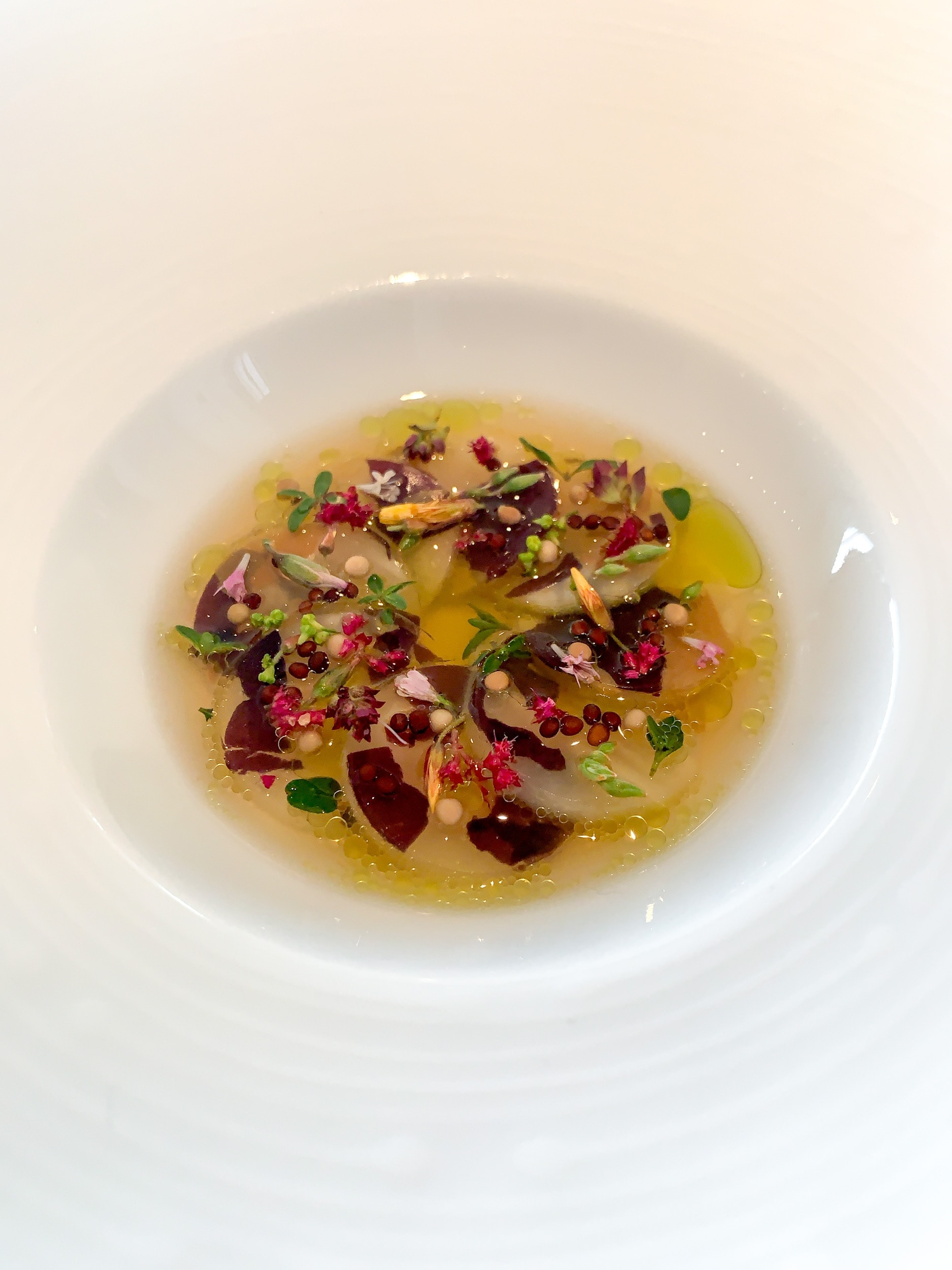 Pickled celeriac with sol, dried mussels, and aromatic seeds