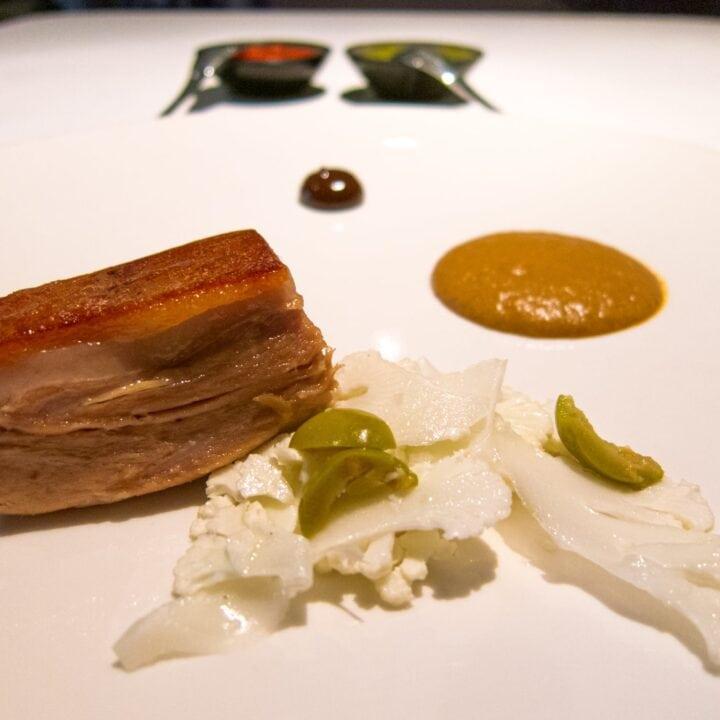 Pork confit, mole, tamarind, and white cabbage
