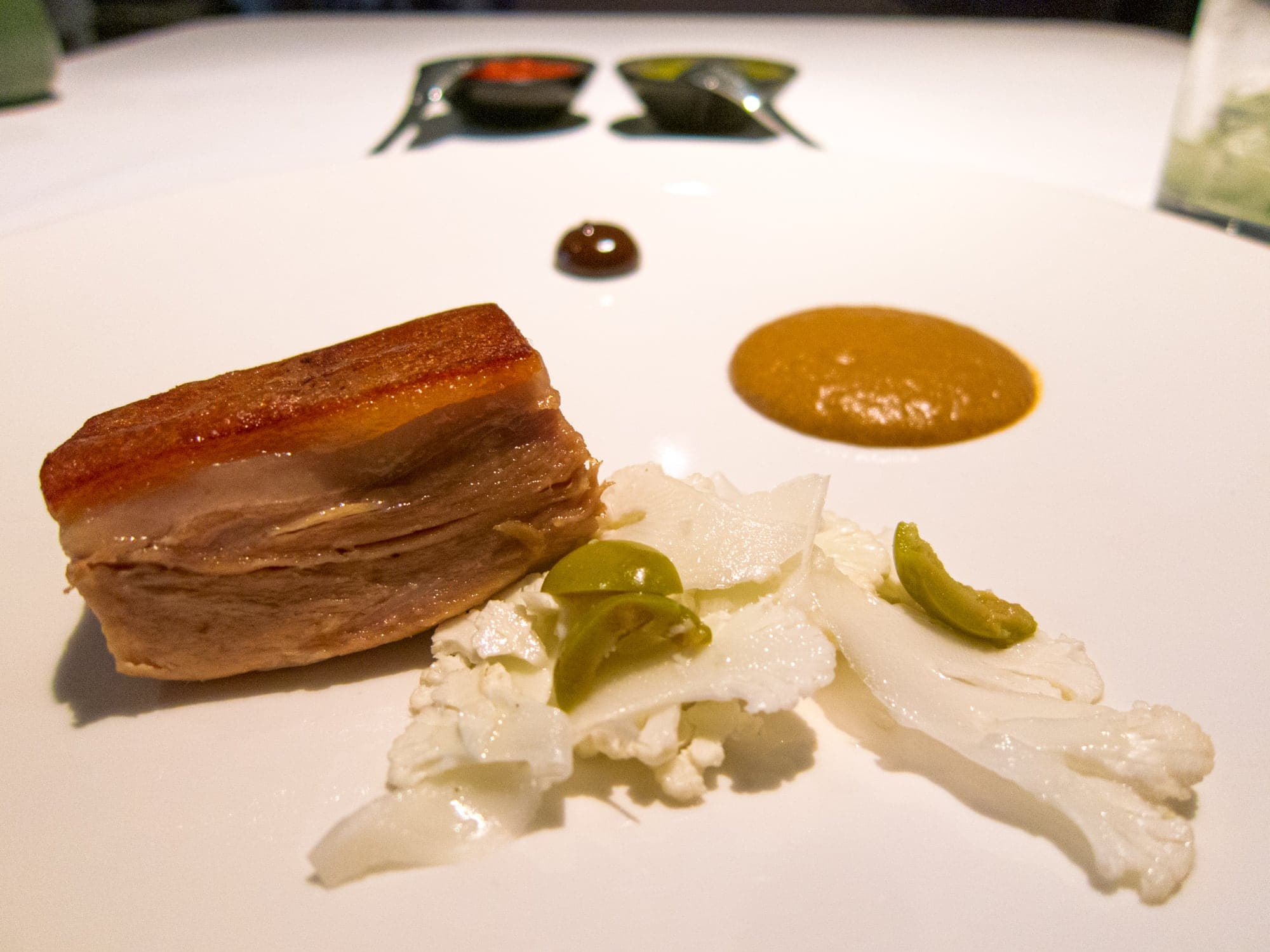 Pork confit, mole, tamarind, and white cabbage