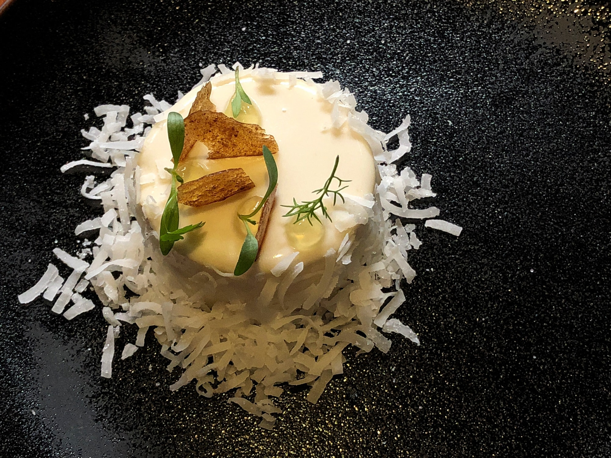 Coconut passion fruit dessert at Sud 777 in Mexico City