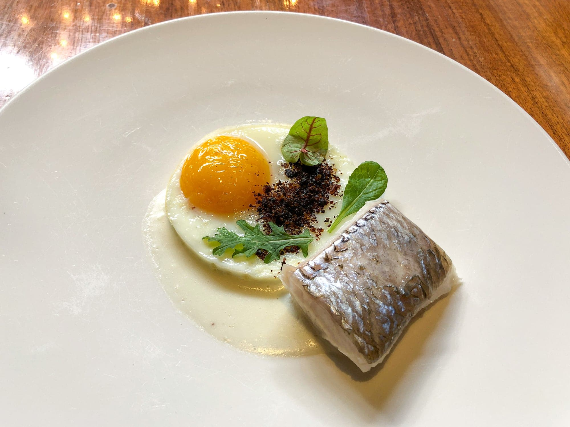 Sea bass and farm fresh egg at Sud 777 in Mexico City
