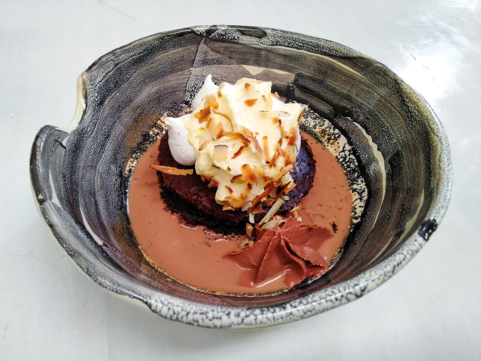 Devil's food cake, coconut pavlova, 76% cacao mousse, dark chocolate and chipotle soup