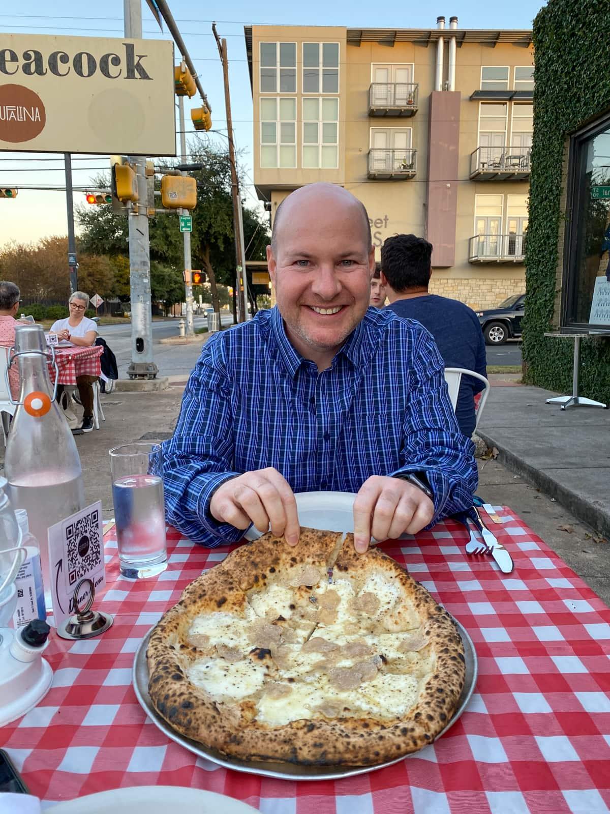 Dave with cacio e pepe and white truffle pizza at Bufalina