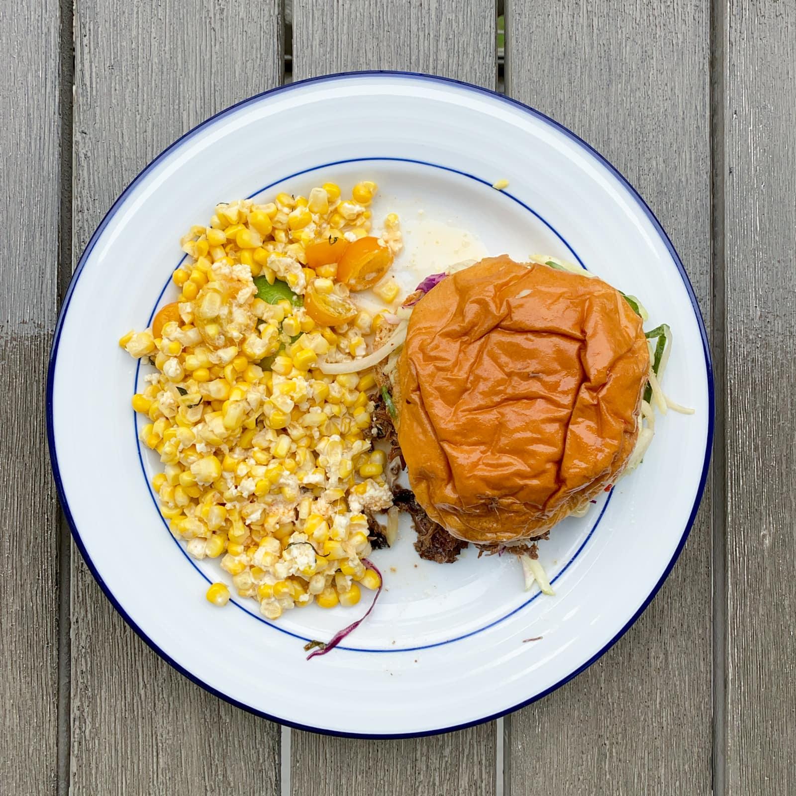 Oak smoked beef brisket sandwich with TX sweet corn from Loro