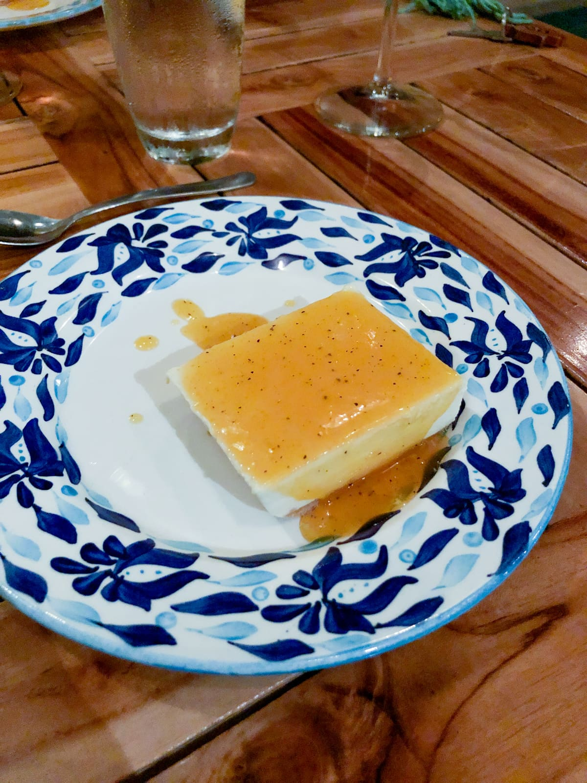 Cheesecake with passion fruit sauce