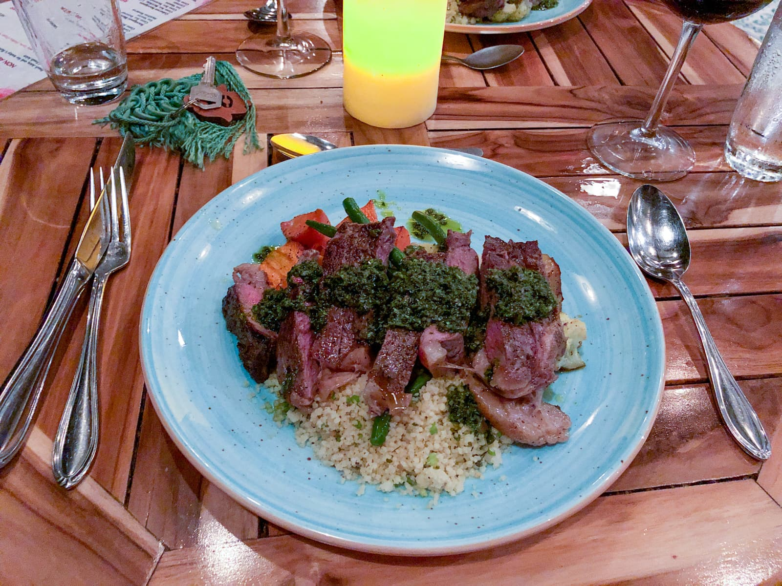 Steak with chimichurri sauce and couscous