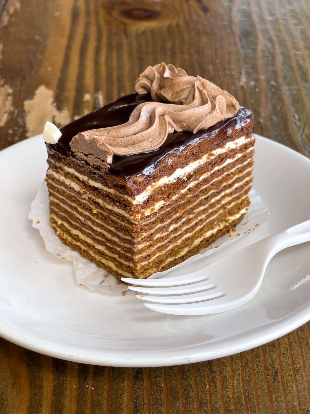 Sour cream cake with honey sponge
